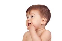 可爱的女婴用在她的嘴的现有量 免版税库存照片