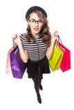 可爱的妇女一张顶视图有购物袋的在白色背景 免版税库存照片