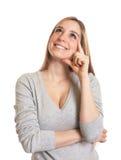 可爱的妇女有一个想法 免版税库存照片