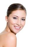 可爱的妇女的微笑的美丽的表面 免版税库存照片