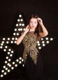 年轻可爱的妇女,时尚画象  得出准备好的星形向量的背景下载 免版税库存图片