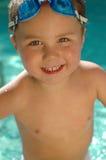 可爱的婴孩游泳 免版税库存图片