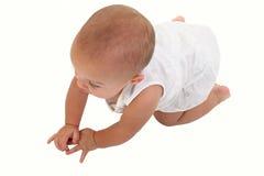 可爱的婴孩爬行的楼层女孩 免版税图库摄影