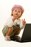 可爱的婴孩膝上型计算机 免版税库存照片
