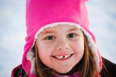 可爱的小女孩关闭在雪 免版税图库摄影