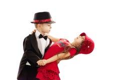 可爱的小男孩和女孩跳舞 免版税库存照片