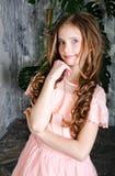 可爱的微笑的常设女孩孩子画象  图库摄影
