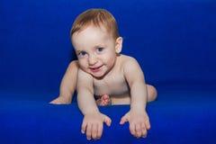 可爱的微笑的婴孩画象  库存图片