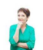 可爱的情感妇女50岁,隔绝在白色backg 免版税库存照片