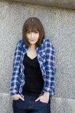 可爱的方格的青少年女孩严重的衬衣 库存照片