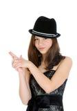 可爱的深色的新十几岁的女孩用在枪的形状的现有量 免版税图库摄影