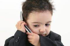 可爱的男婴移动电话诉讼 免版税库存照片