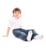 可爱的男孩坐的年轻人 免版税图库摄影