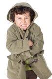 可爱的男孩被凝结 免版税库存照片
