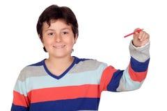可爱的男孩铅笔红色 免版税库存图片