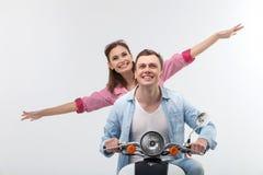 可爱的男朋友和女朋友马达自行车的 库存图片