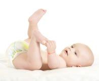 可爱的男婴纵容 图库摄影
