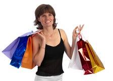可爱的白种人购物妇女 免版税库存图片