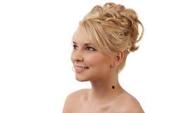 可爱的白肤金发的正式发型妇女 免版税库存图片