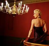 可爱的白肤金发的照片妇女 免版税库存图片