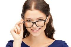 可爱的眼镜妇女 免版税库存照片