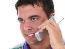 可爱的移动电话人微笑的联系的年轻&# 免版税库存照片