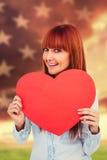 可爱的行家妇女的综合图象在红色心脏后的 库存照片