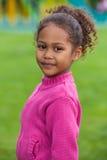 可爱的非洲亚裔女孩少许纵向 免版税图库摄影