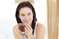 可爱的饮用的茶妇女 库存照片