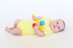 可爱的2个月画象有吵闹声的女婴 免版税图库摄影