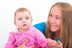 可爱的婴孩和保姆 免版税图库摄影