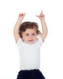 可爱的婴孩用他的手提高了请求词 库存图片