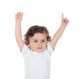 可爱的婴孩用他的手提高了请求词 免版税图库摄影