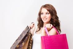 可爱的年轻顾客妇女。 图库摄影