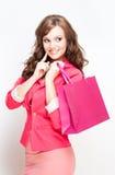 可爱的年轻顾客妇女。 免版税库存照片