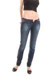 可爱蓝色女孩的牛仔裤脱下衣服 库存照片