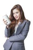 可爱年轻的女商人提出一个罐头软饮料 免版税库存照片
