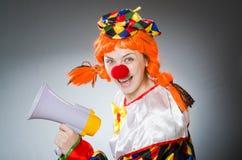 可笑概念的滑稽的小丑 免版税库存照片