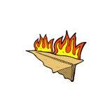 可笑的动画片灼烧的纸飞机 免版税库存照片