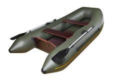 可膨胀的橡皮艇由PVC,绿色,双制成,与桨。 免版税图库摄影
