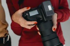 2台照相机数字式查出的照片支持白色 图库摄影