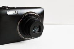 2台照相机数字式查出的照片支持白色 免版税库存图片