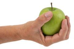 史密斯老婆婆苹果在手中 免版税库存图片