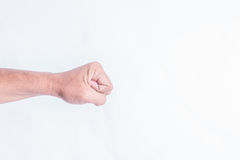 右男性手特写镜头被举握紧拳头 免版税库存照片