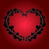 从叶子的华伦泰心脏在红色背景 免版税库存照片