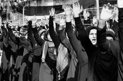 什叶派回教徒妇女呼喊伊斯兰教的口号阿修罗队伍 库存照片