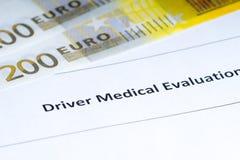 司机医疗评估,纸币 免版税图库摄影