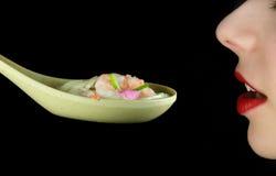 吃东方汤妇女 图库摄影