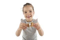 吃亚洲曲奇饼的小女孩 库存图片