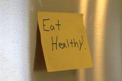 吃健康写了在稠粘的笔记 免版税图库摄影